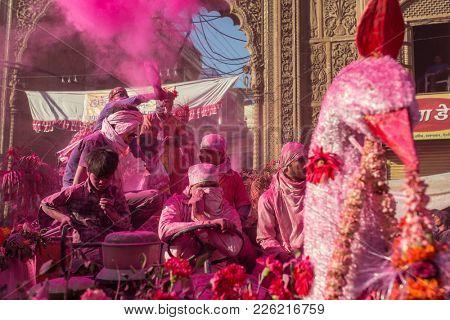 Mathura, India - March 23, 2016: Colourful Holi procession on the streets of Mathura, Uttar Pradesh, India.