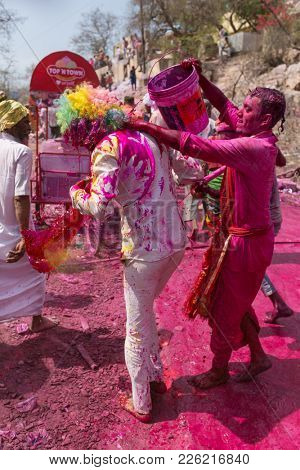 Barsana, India - March 17, 2016: Hindu devotees celebrate Lathmar Holi in Barsana village, Uttar Pradesh, India.
