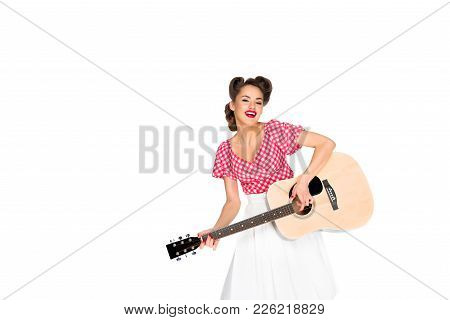 Portrait Of Cheerful Woman In Pin Up Clothing Playing Guitar Isolated On White
