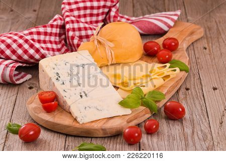 Various Type Of Italian Cheeses On Cutting Board.