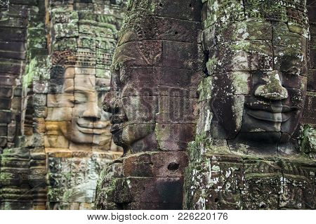 Bayon Temple Angkor Thom, The Serenity Of The Stone Faces Cambodia. Huge Sculptures Of Faces In The