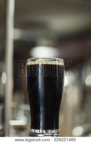 Pint Of Stout In A Brewery
