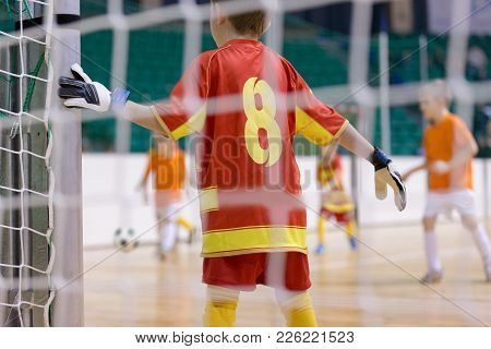 Football Futsal Training For Children. Indoor Football Goalkeeper Standing In Goal. Indoor Soccer Yo