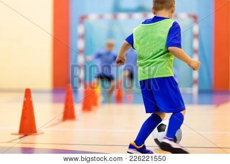 Soccer Training Dribbling Cone Drill. Football Futsal Training For Children. Indoor Soccer Young Pla
