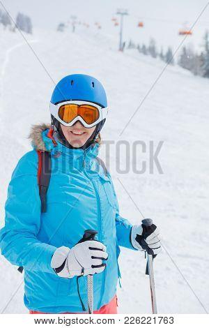 Portrait Of Happy Female Skier In Snowy Alps, Europe