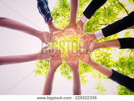 Young Asian People Putting Their Hands Together,teamwork With Stack Of Them Hands Showing Unity,join