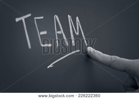 Young Asian Women Writing Teamwork On Backboard,teamwork Concept.