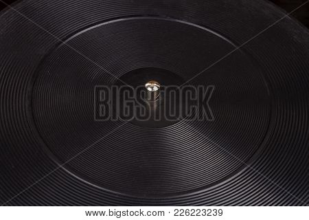 Close Up Shot Of Old Turntable Rubber Platter With The Spindle