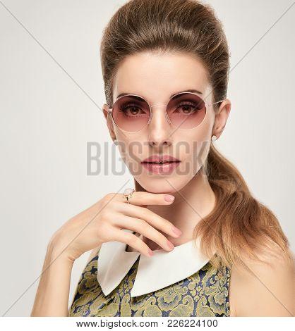 Beautiful Lady In Elegant Dress. Fashion Young Woman, Trendy Sunglasses. Studio Portrait Glamour Mod
