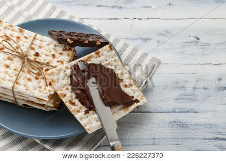 Matzah Bread With Chocolate Cream And Knife
