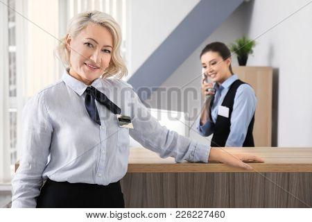 Female hotel receptionist at workplace