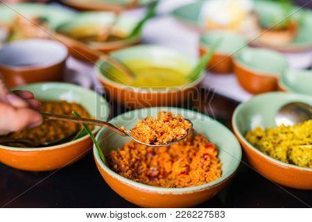 Coconut sambal close up on table with Sri Lankan food
