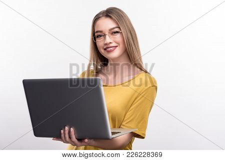 Young Professional. Cheerful Pretty Woman In A Mustard Blouse Holding A Laptop And Posing With It, I