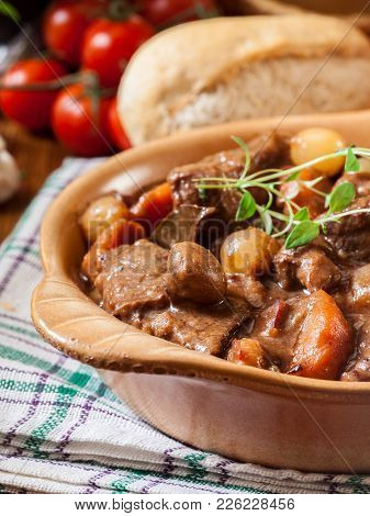 Beef Bourguignon Stew Served With Baguette