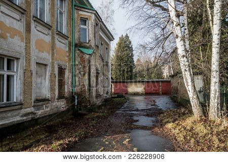 Abandoned Haunted House In A Late Autumn In Sunny Weather With Garages