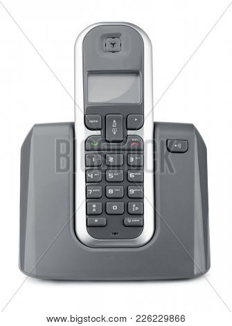Front view of wireless dect phone on charging station isolated on white