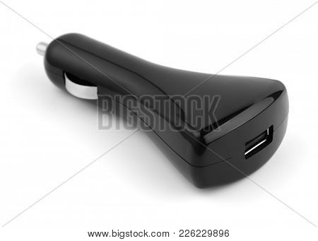 Black USB car charger isolated on white