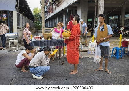Bangkok, Thailand - June 28, 2015: People Praying Respect To Monk On Bangkok Street. Roughly 95 Perc