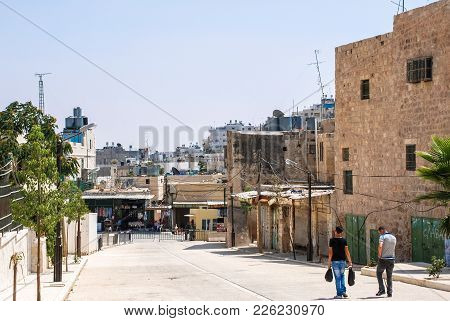Hebron, Israel - August 04, 2010: Vertical Picture Of Garbage On The Net Above The Local Market In H