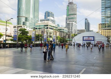Bangkok, Thailand - June 29, 2015: People Walking On Spacious Sidewalk In Front Of Central World Bui