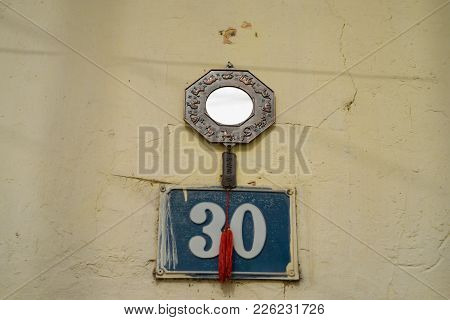 Hanoi, Vietnam - Feb 28, 2016: Feng Shui Object On Entrance Wall Of A House In Hanoi. In Vietnamese