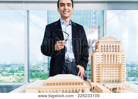 Indian architect in office with architecture model