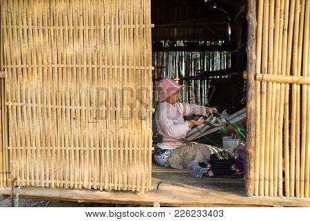 Kon Tum, Vietnam - Mar 28, 2016: Bahnar Woman Weaves Clothing Inside Of Her House In Kon Kotu Villag
