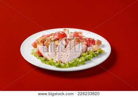 Caesar Salad With Chicken, Tomatoes, Breadcrumbs, Cheese Top, Decorated With Lettuce Leaves On A Mon