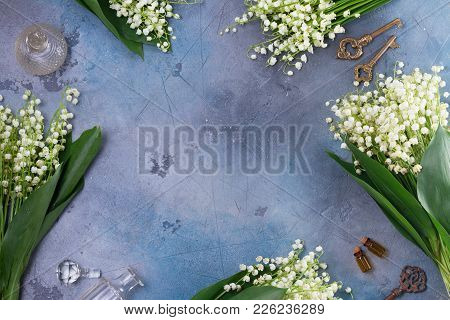 Lilly Of The Valley Flowers And Keys On Gray Background With Copy Space