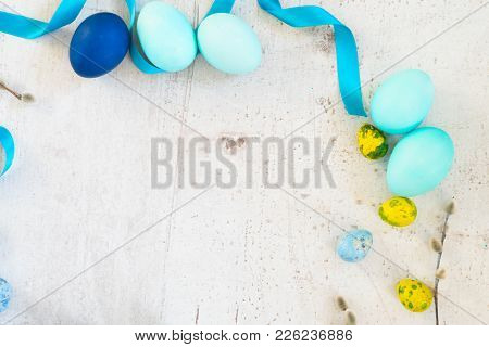 Blue Colored Easter Eggs And Catkins Twigs Frame On White Aged Wooden Tabletop With Copy Space