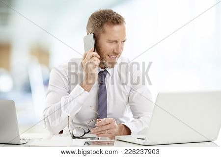 Businessman Consulting On Mobile Phone With His Client