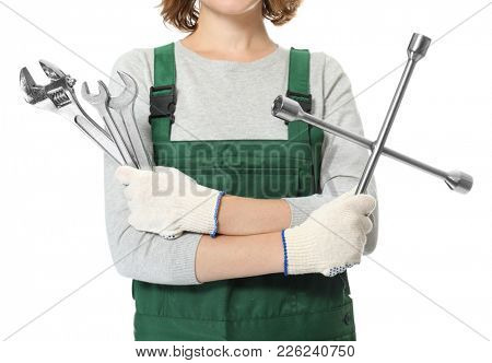 Female auto mechanic with tools on white background, closeup