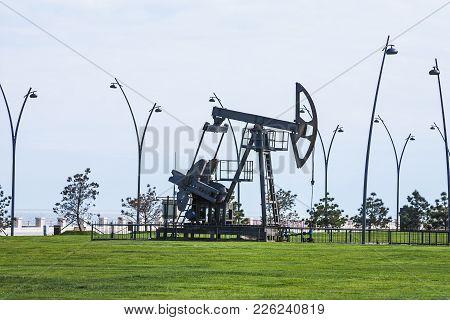 Oil Pump Pumping Oil In Former Oil Fields. Equipment Of The Oil Industry. Baku, Azerbaijan,