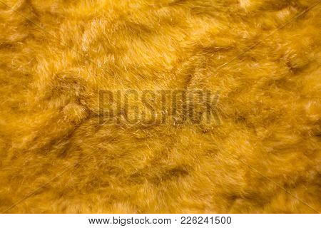 Artificial Vintage Fur (fake Fur). Yellow Fur Pattern Background. Macro Material.