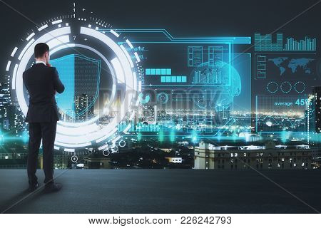 Businessman On Rooftop Looking At Abstract Digital Business Screen. Innovation And Finance Concept.