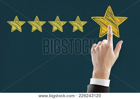 Businessman Pointing At Abstract Stars On Blue Background. Experience Rating And Satisfy Concept