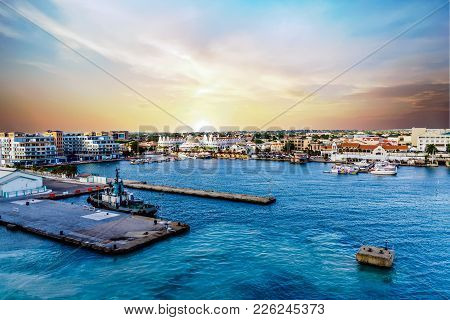 Tugboat And Yachts In Late Afternoon In Aruba Port
