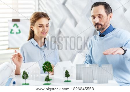 Happy Working. Handsome Exuberant Bearded Man Smiling And Working With His Colleague On A Project Wh
