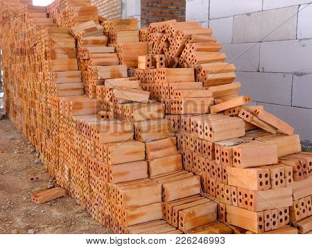 Pile Of Red Bricks Which Is Prepared For Construction