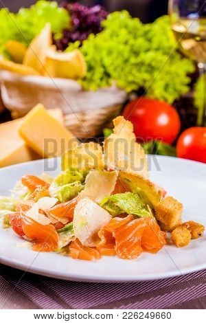 Caesar Salad With Salmon On White Plate