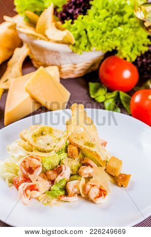 Caesar Salad With Shrimps On White Plate
