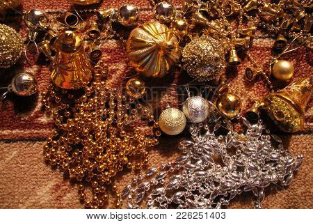 Beautiful Golden Bells And Balls, Chain, Beads Shine And Sparkling For Decoration On Christmas And N