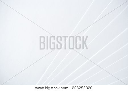White Minimalistic Geometric Paper Background With A Light-shadow Pattern And With Copy Space.