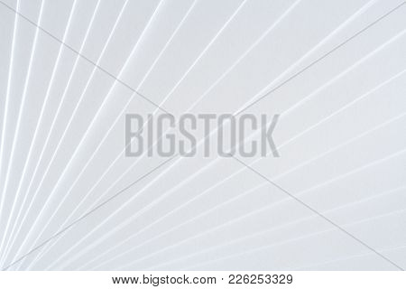 White Geometric Pattern Of Clean Paper Sheets, Spaced As Fan.