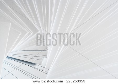 White Background From Stack Of Clean Sheets  Paper, Laid Out Randomly In A Spiral.