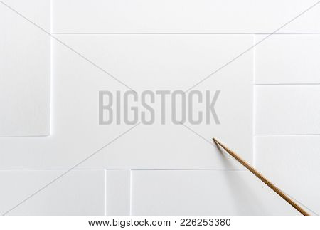 White Paper Blank Minimalist Layout With Copy Space And A Wooden Pointer.