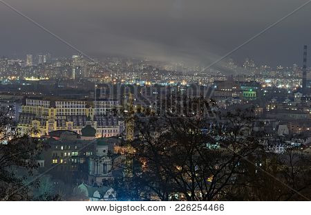 View Of The Ancient Podil District And Modern Obolon District At Background. Evening City Panorama.