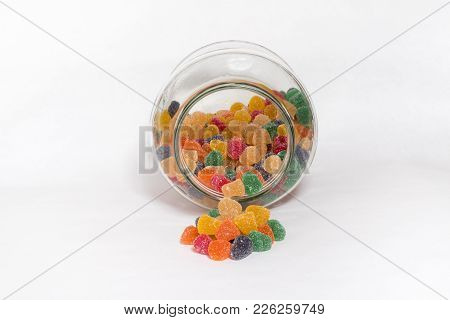 Transparent Bottle Reclining Front View With Full Colored Gummies