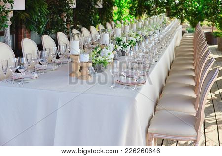Outdoor Wedding Celebration At A Restaurant. Festive Table Setting, Catering. Wedding In Rustic Styl