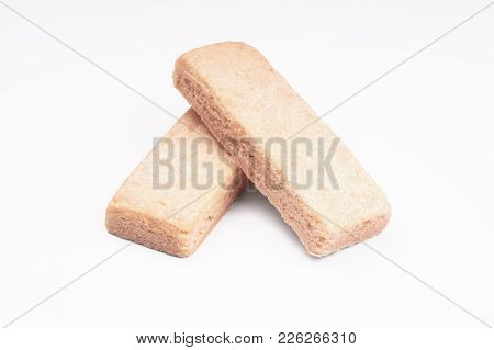 Two Traditional Scottish Shortbread Finger Biscuits Or Cookies On White Background With Shadow
